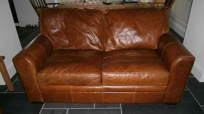 Cushion re-padding and leather conditioning - BEFORE